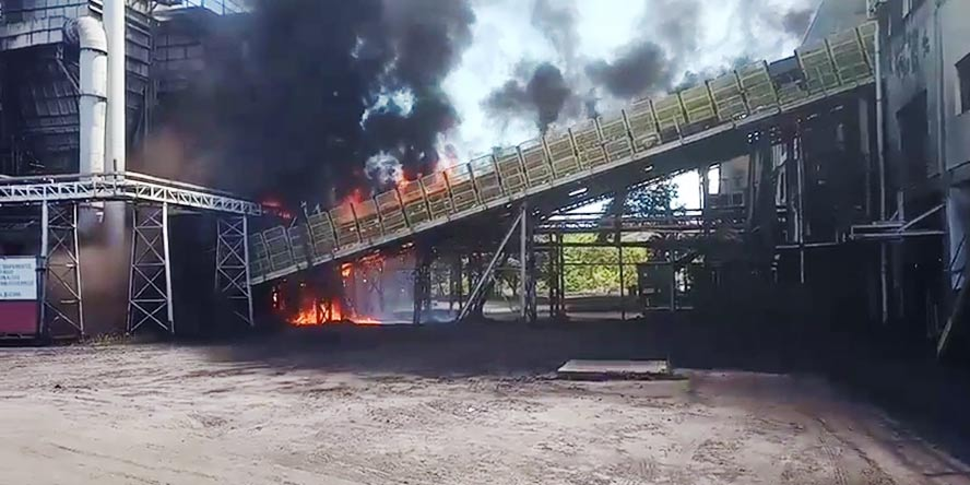 Fire on a conveyor belt transporting petroleum coke